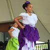Kevin Martin — The Morning Journal <br> Members of Puerto Rican dance group Esencia Boricua Cultural de Lorain perform on the main stage at Black River Landing on June 24 at the 51st annual Lorain International Festival. The group is in its 36th year of performing in the International Festival.
