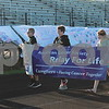 Deanna Frances for Shaw Media<br /> Cancer survivors, caregivers and community members walk during the ceremonial first lap of the Relay for Life DeKalb County event on Saturday at Sycamore High School, 427 Spartan Trail, Sycamore.