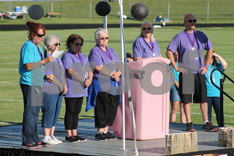 Deanna Frances for Shaw Media<br /> Cancer survivors tell their stories during the opening ceremony of Relay for Life DeKalb County on Saturday at Sycamore High School, 427 Spartan Trail.