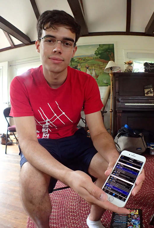 . Jonathan Tressler - The News-Herald. Case Amateur Radio Club member Aidan Montare displays some of the information available through an app on his phone that tracks various amateur-radio-user-accessible satellites for ham-radio communication purposes.