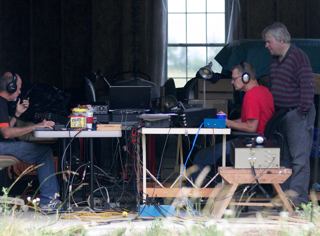 . Jonathan Tressler - The News-Herald. From left, Orange Village resident Jim Stahl, Gary Mikitin from Mayfield Heights and Jim Galm participate in the 2018 American Radio Relay League Field Exercise at Galm�s Huntsburg Township property.