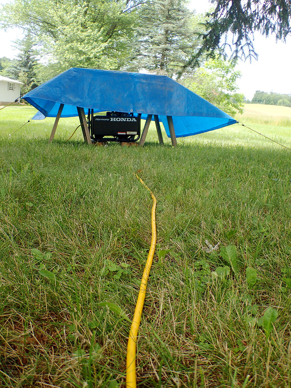 . Jonathan Tressler - The News-Herald. A cable leads from the generator providing the required off-the-grid juice to the ham-radio setup Jim Galm, Gary Mikitin and Jim Stahl used to participate in the American Radio Relay League�s 2018 Field Day Exercise at Galm�s property in Huntsburg Township.