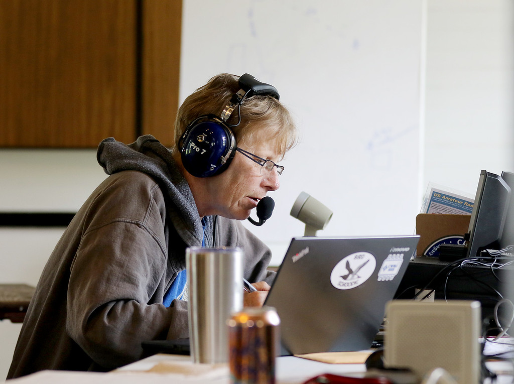 . Jonathan Tressler - The News-Herald. Laura Gooch communicates via ham radio while participating with the Case Amateur Radio Club in the 24-hour American Radio Relay League 2018 Field Day Exercise during the last few hours of th event June 24 at Case Western Reserve University�s Squire Valleevue Farm in Hunting Valley.