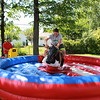 Antonio Mangelluzzi, who is 15-years-old, riding an inflatable mechanical bull at the 24th annual Mayfield Heights Unity Days Festival on June 25. (Tawana Roberts/The News-Herald)