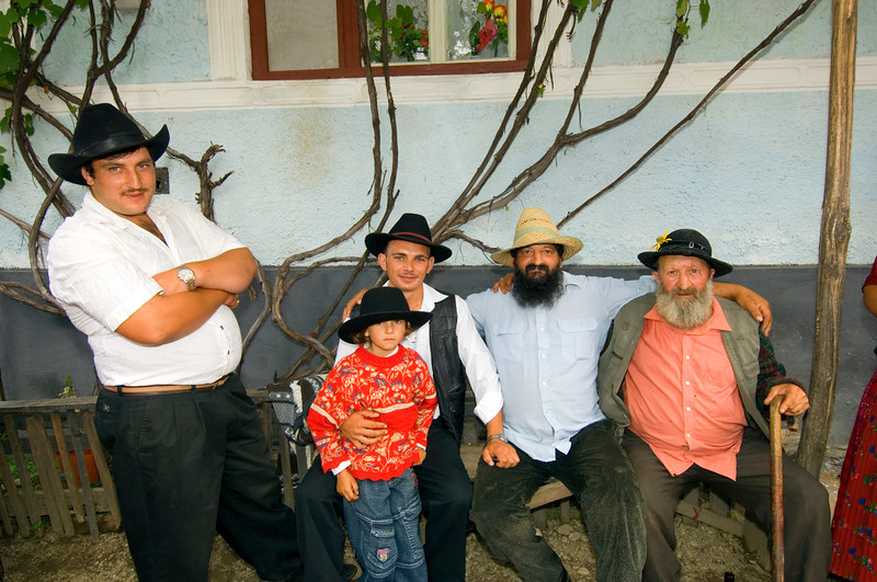 Europe, Romania, Transylvania, Gypsy wedding,  Roma men at wedding party at bride's home