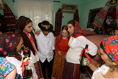 Europe, Romania, Transylvania, Gypsy wedding,  wedding party at bride's home , teenage bride and groom before leaving her home