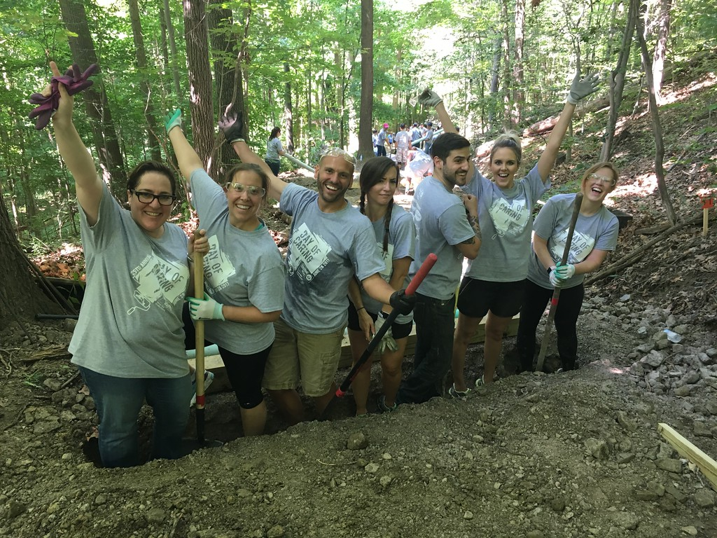 . Volunteers from Avery Dennison were hard at work  installing drainage systems to pull surface water off two wodded hillside trails that lead from the soccer fields to the Grand River during United Way of Lake County\'s 25th annual Day of Caring on Wednesday June 28, 2017. (Submitted)