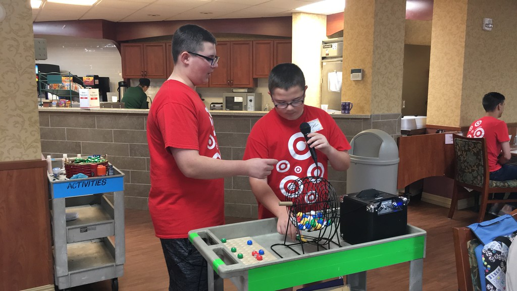 . Josh and Zac Cole volunteer with Target by playing Bingo with residents at Ohio Living Breckenridge Village 36855 Ridge Road during the United Way of Lake County Day of Caring June 28. (Harley Marsh/The News-Herald)