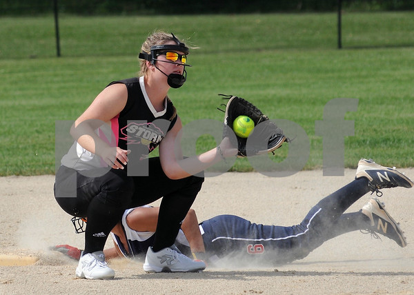 Kishwaukee Valley Storm 18U player Gracyn Gabriel takes a throw at second base in tournament action on Friday in Sycamore.  Steve Bittinger - For Shaw Media