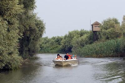 Europe, Romania, The Danube Delta, tourists in a boat