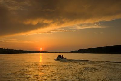 Europe, Romania, The Danube Delta, Mahmudia, sunset over Danube River