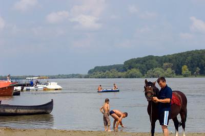 Europe, Romania, The Danube Delta, Mahmudia, local man on the shore with a horse