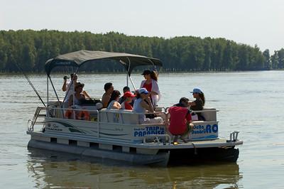 Europe, Romania, The Danube Delta, Mahmudia, tourists take a pleasure boat along Brutal Sfintu Gheorghe