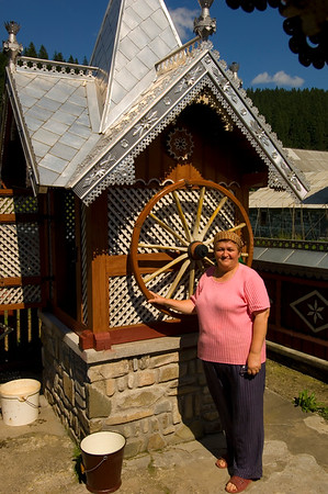 Europe, Romania, Moldavia ,Bucovina, traditional design and architecture for the region, woman by water well