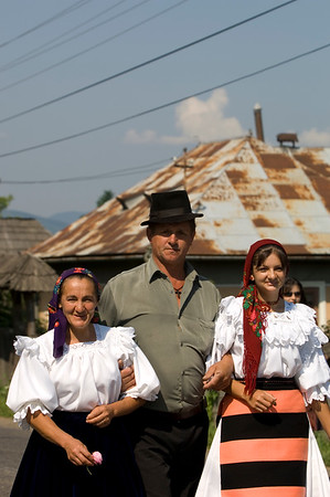 Europe, Romania, Maramures, Salistea De Sus village in Iza Valley, villagers put on traditional folk dress to attend mass at the local church