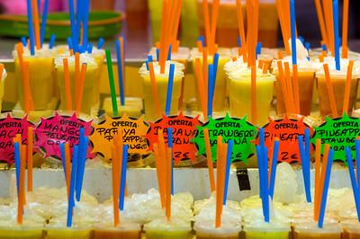 Iced fruit juices on sale in Mercat de la Boqueria, Barcelona, Catalonia, Spain