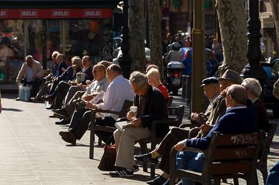 People enjoing afternoon, benches, Las Ramblas, Barcelona, Catalonia, Spain