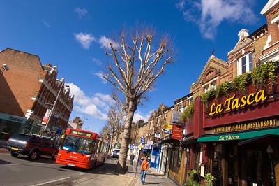 Shops and street traffic on Uxbridge Road, Ealing, W5, London, United Kingdom