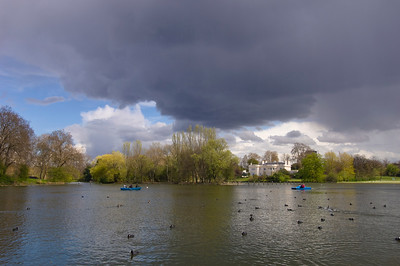 Stormy clouds over boating lake in Regent's Park, NW1, London, United Kingdom