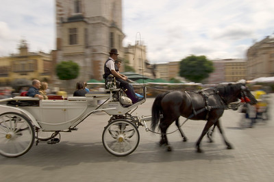 Poland, Cracow, horse drawn carriage on Main Square