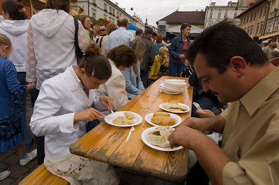 Poland, Cracow, Rynek Nowy and people eating pierogi, Old Town