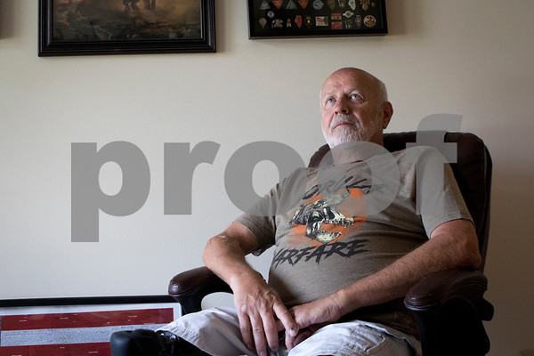 Sam Buckner for Shaw Media.<br /> Herb Holderman, a vietnam war veteren poses for a photo in his home on Sunday July 2, 2017.