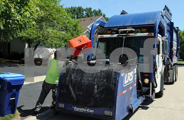 A  Lakeshore Recycling Systems driver makes collections on Monday, July 2 during the company's first week of operations in St. Charles.<br /> Steve Bittinger - For Shaw Media