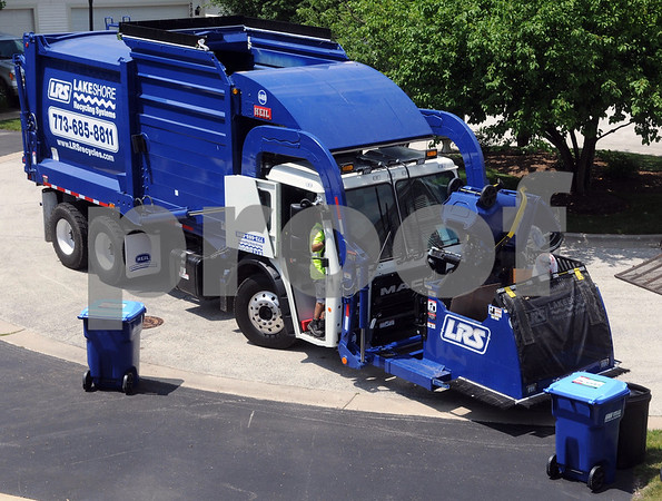 A  Lakeshore Recycling Systems truck makes collections on Tuesday, July 3 during the company's first week of operations in St. Charles.<br /> Steve Bittinger - For Shaw Media