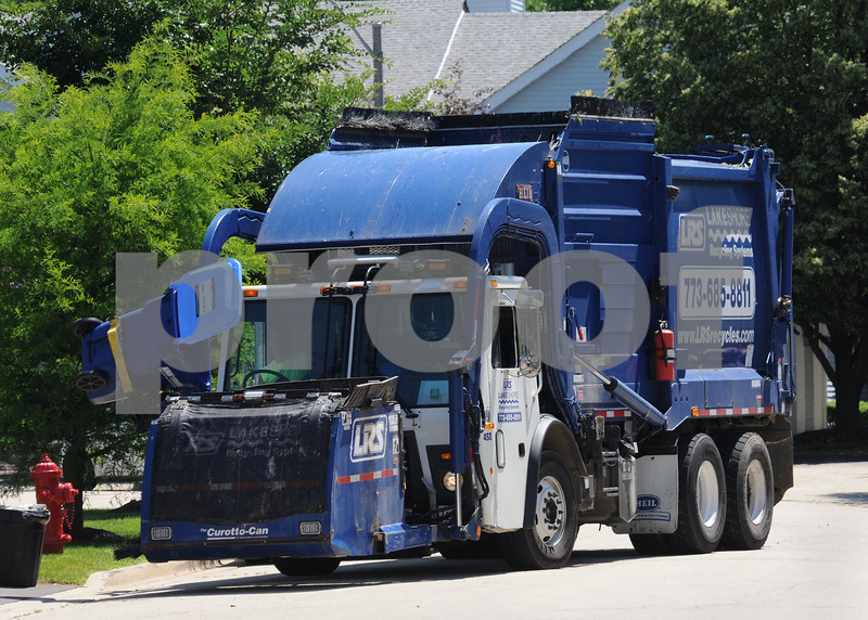 A  Lakeshore Recycling Systems truck makes collections on Monday, July 2 during the company's first week of operations in St. Charles.<br /> Steve Bittinger - For Shaw Media