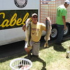 Richard Payerchin - The Morning Journal <br> Walleye specialist Jason Kopf of Avon Lake holds up two of the walleye his team caught July 2, 2016, in the fourth annual Hooks for Hunger Walleye Tournament, a fundraiser for Community Resource Services. The agency seeks to alleviate poverty in Avon Lake and Avon.