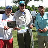 Richard Payerchin - The Morning Journal <br> Third place winners Scott Kozlowski, Dave Rankin and Walt Knebusch show off their trophy and prizes for the fourth annual Hooks for Hunger Walleye Tournament, a fundraiser for Community Resource Services. The agency seeks to alleviate poverty in Avon Lake and Avon.