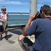 Richard Payerchin - The Morning Journal <br> Damien Lusardo, 5, of Avon Lake, holds up a sheephead he caught at the Miller Road Park Pier on July 2, 2016, as his father, Anthony Lusardo, snaps a photograph of the catch. They were on the pier among participants in a youth fishing derby held by the Avon Lake Parks and Recreation Department in conjunction with the fourth annual Hooks for Hunger Walleye Tournament, a fundraiser for Community Resource Services. The agency seeks to alleviate poverty in Avon Lake and Avon.