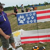 "Richard Payerchin - The Morning Journal <br> Phil Broder of Lewisberry, Pa., displays ""In Dog We Trust,"" a box kite he made decorated with paw prints from his dog, as part of the inaugural Over the Rainbow Kite Festival on July 2. Victory Park Ohio hosted the event as a fundraiser for Rainbow Babies & Children's Hospital."
