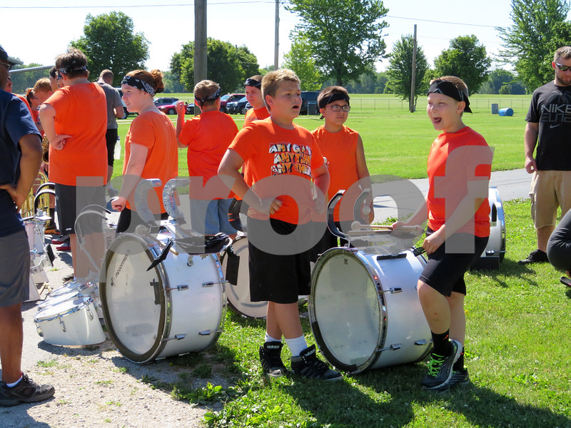 Thomas Malton (facing forward from left), 13, Breyden Johnson, 12, and Brody Skorup, 12, all of Sandwich, wait with the rest of the Sandwich Middle School band Saturday for the town's Fourth of July parade to begin.