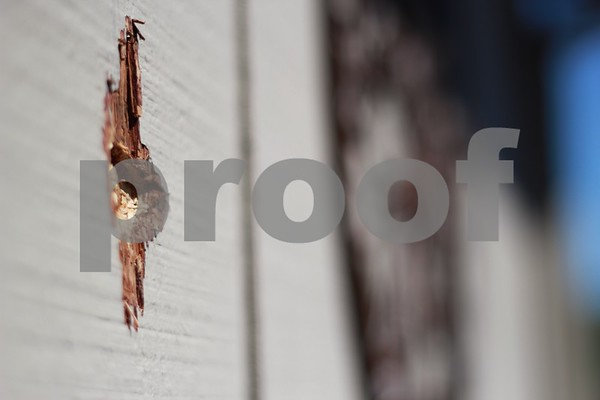 A bullet hole remains in the side of Cody Wheaton's Lillian Lane home Sunday morning, after a man was shot across the street at approximately 12:30 a.m. July 2.  Photo by Ben Draper - bdraper@shawmedia.com