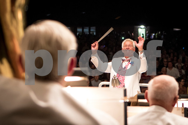 Sam Buckner for Shaw Media.<br /> DeKalb Municiple Band director Kirk Lundbeck conducts the band during the fireworks finale on Tuesday July 4, 2017 at Hopkins Park in DeKalb.