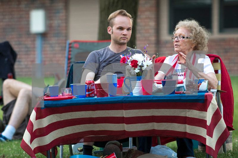 Sam Buckner for Shaw Media.<br /> Alex Wanke and Hansen Wanke sit at a table in Hopkins Park on Tuesday July 4, 2017.