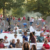 Sam Buckner for Shaw Media.<br /> Crowds sit in the bleachers in front of the bandshell several hours before the fireworks start on Tuesday July 4, 2017 at Hopkins Park.