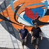 Chad Felton — The News-Herald <br> Roy Reid, left, and Bob Peck on July 1 in front of the public art project approved by Euclid's Architectural Review Board. Peck's mural, an abstract expression, is a mix of spray paint and latex paint.