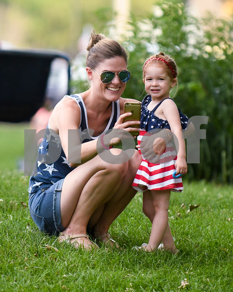 Elisabeth Clary and her daughter Lilyana Clary 2 years old of DeKalb stop and take a photo as they hang out before the fireworks in Hopkins Park on July fourth.
