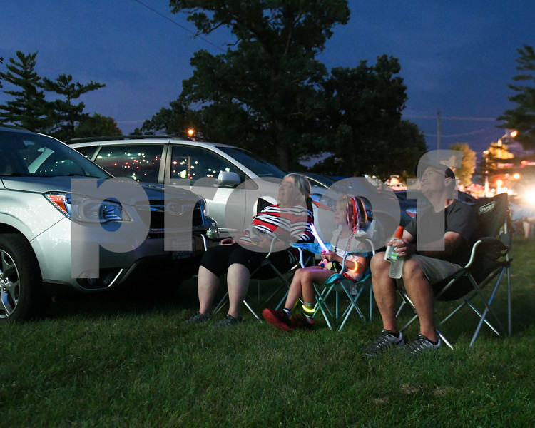 Grandparents Christine Bruelle and husbandd Andy Brulle of Sycamore sit with their granddaughter Emma Chumacher of Fort Washington Wisconsin watch fireworks at Hopkins Park during the Fourth of July celebration on July 4th celebration.