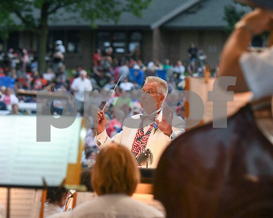 Kirk Lundbeck the DeKalb municipal band conductor conducts during the fourth of July performance at Hopkins Park.