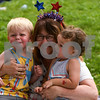 Two year old Jackson Kooistra of Sugar Grove, left, and Parker Hallanan of Genoa three year old, right, take a photo with their grandmother Samantha Ceruenka of Genoa