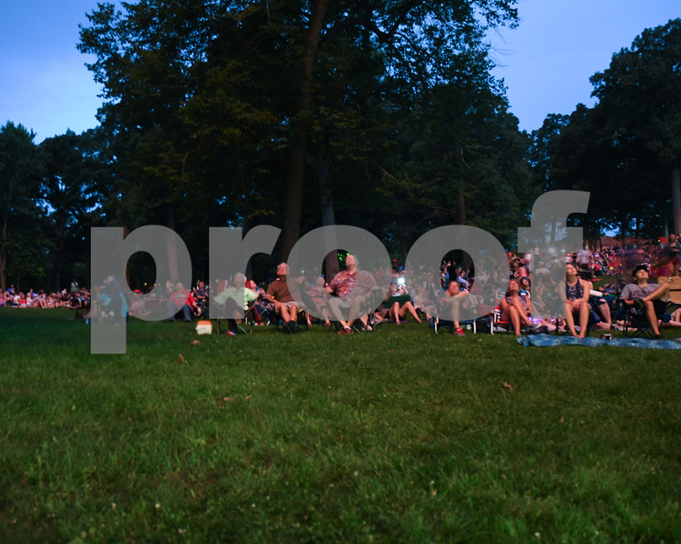 Spectators watch as the DeKalb Municipal band plays as fireworks go off for the fourth of July.