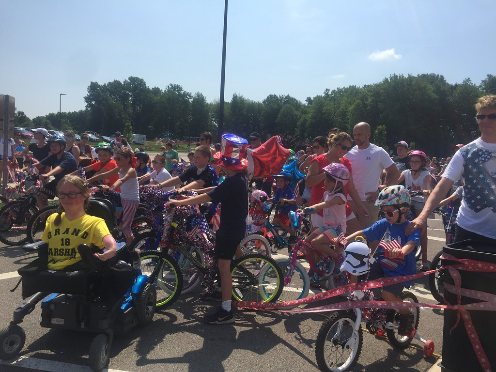 . Kevin Martin � The Morning Journal <br> Participants in the third annual Great Avon Bike Parade prepare at the starting line on July 4 at the Avon Aquatic Facility at 36265 Detroit Road.
