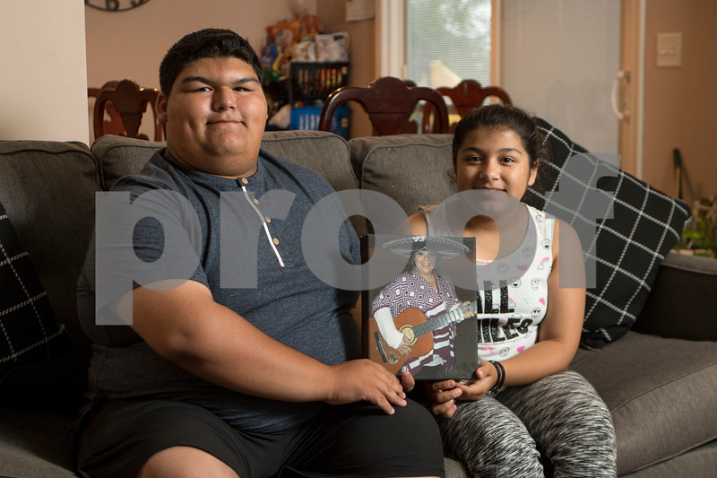 Sam Buckner for Shaw Media.<br /> Santana and Zoey Juarez hold a photo of their mother Lidia Juarez on Wednesday July 5, 2017 in a family members house.