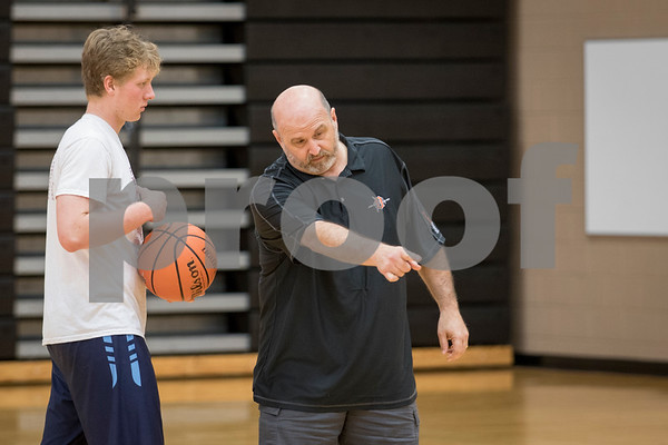 Sam Buckner for Shaw Media.<br /> Head coach Al Biancalana gives instruction to Mikey Vilet on Thursday July 6, 2017.
