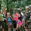 Jonathan Tressler - The News-Herald. Holden Arboretum guide Eva Stephans talks about the northern hardwood forest along the trail to the top of Little Mountain June 11 during a family hike tour of the area.