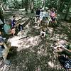 Jonathan Tressler - The News-Herald. Holden Arboretum guide Eva Stephans, far right, talks about the social history of Little Mountain during a family hike June 11. The group is gathered around a monument to the Church of the Transfiguration, which stood there from 1893 to 1916.