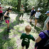 Jonathan Tressler - The News-Herald. Visitors to the top of the Holden Arboretum's Little Mountain parcel stand around an area, once occupied by horse stables, now covered in moss during a June 11 guided hike.
